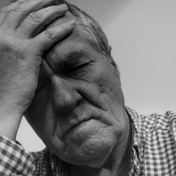 Man suffering effects of fatigue